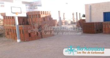 Premières briques de la cantine scoclaire de Ouled Yaneg